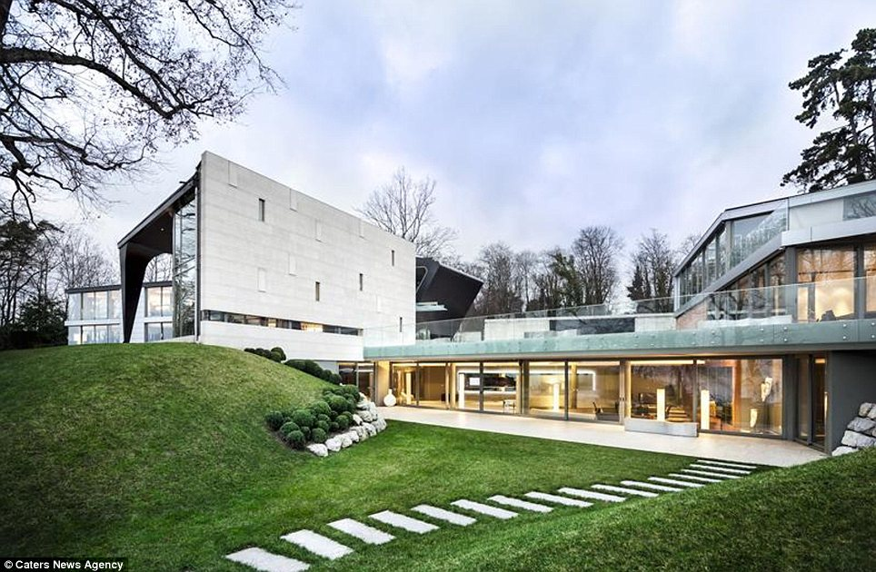 Peaceful: This house in a star-studded neighbourhood on the shore of Lake Geneva has gone up for sale for £50million