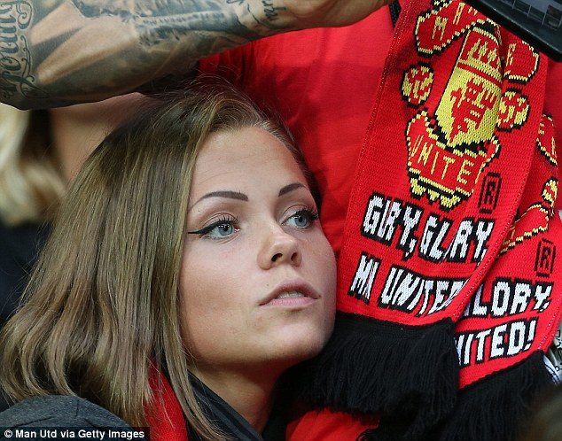 Keen eye: A Manchester United fan in the stands at the Friends Arena in Stockholm