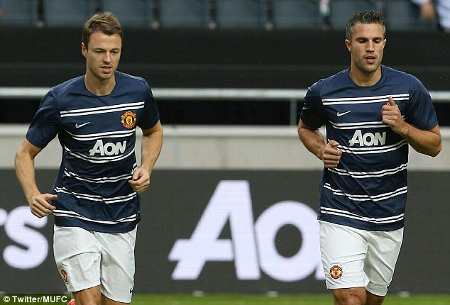 Preparing: Jonny Evans (left) and Robin van Persie warm up for the friendly against AIK