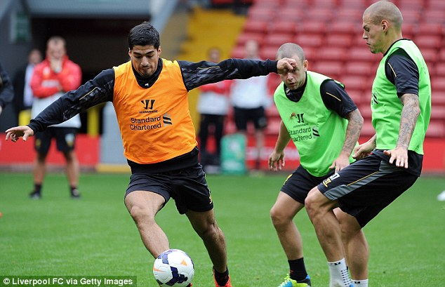 On the ball: Luis Suarez has told Liverpool that he wants to leave after accusing the club of failing to keep their promise