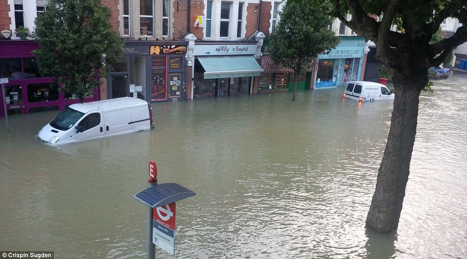 Submerged: The water has risen to an astonishing level in a short period, leaving cars stricken
