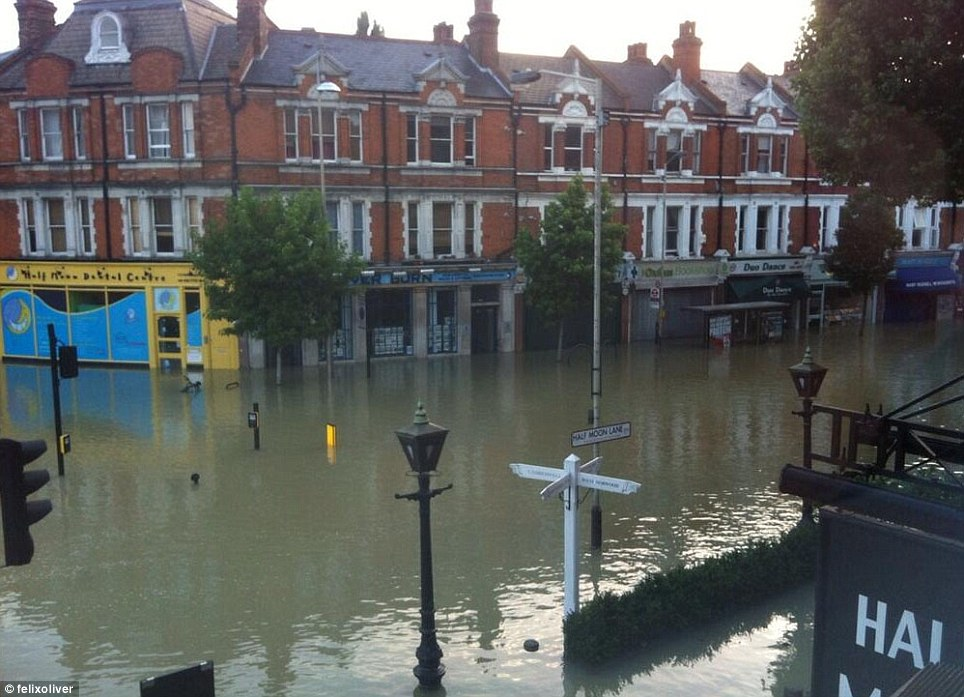 Eerie: This was the scene at the junction of Herne Hill and Half Moon lane this morning, where residents took these pictures from their windows