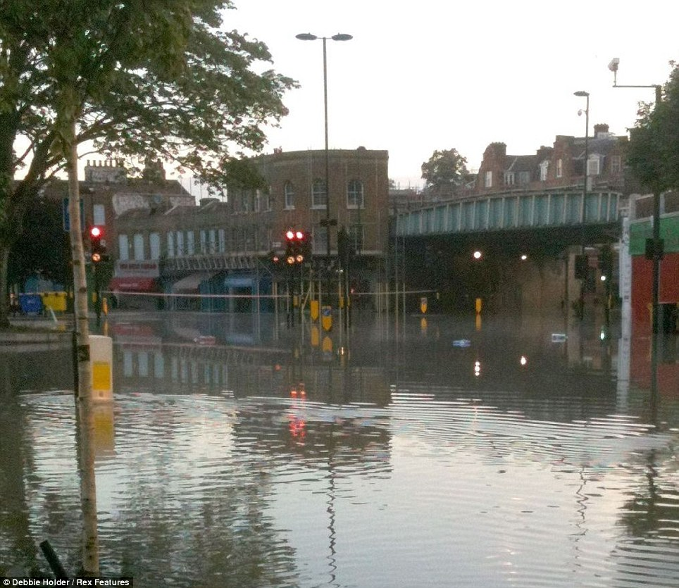 Problems: A large area of Herne Hill has flooded after a 3ft wide mains pipe burst, sending thousands of gallons of water into the area