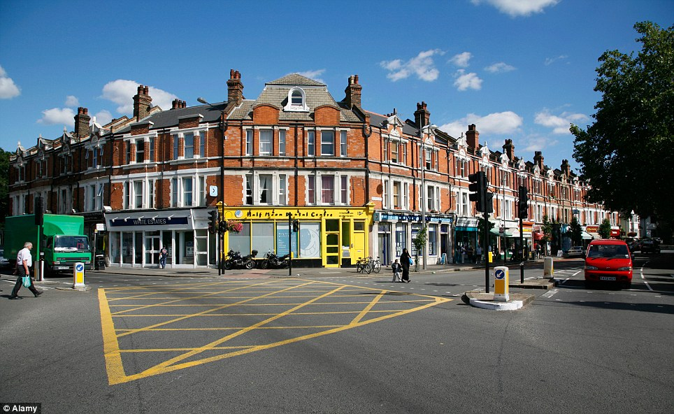 Spot the difference: The flooded junction in London suburb Herne Hill in happier and drier times