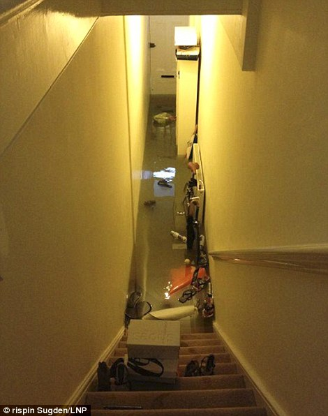 Meanwhile inside a nearby flat the water filled its hallway
