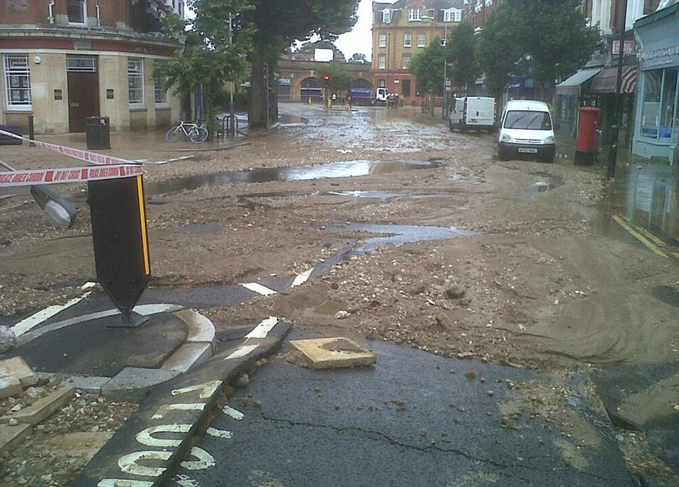 Clear-up: A picture tweeted by the London Fire brigade shows how after the flood subsided, it left behind a trail of dirt