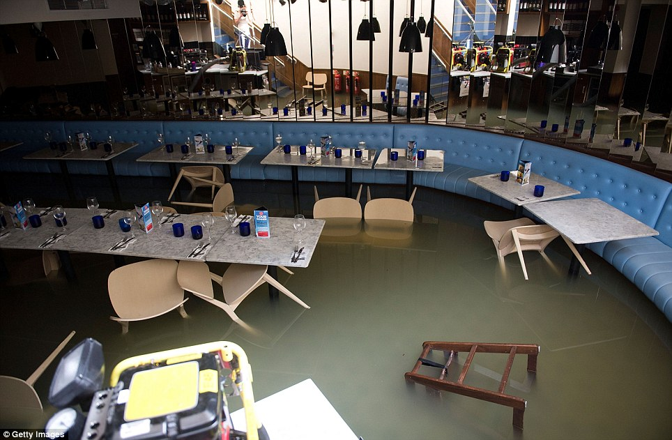 Aftermath: The flooded Pizza Express restaurant on Half Moon Lane in Herne Hill, one of several businesses to be hit