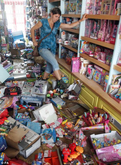 Disaster zone: Vicky Brown, 39, owner of Just Williams toy shop, left, and Alex Kaminska, 28, of the Four Ways Pharmacy assess the damage done to their shops and their stock