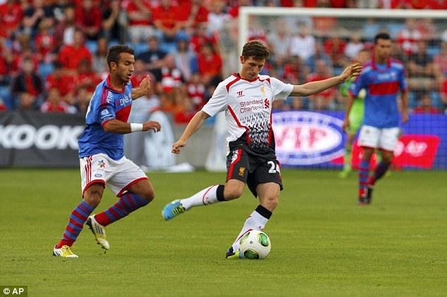 Under pressure: Joe Allen plays a pass as Valerenga's Mohamed Fellah closes in
