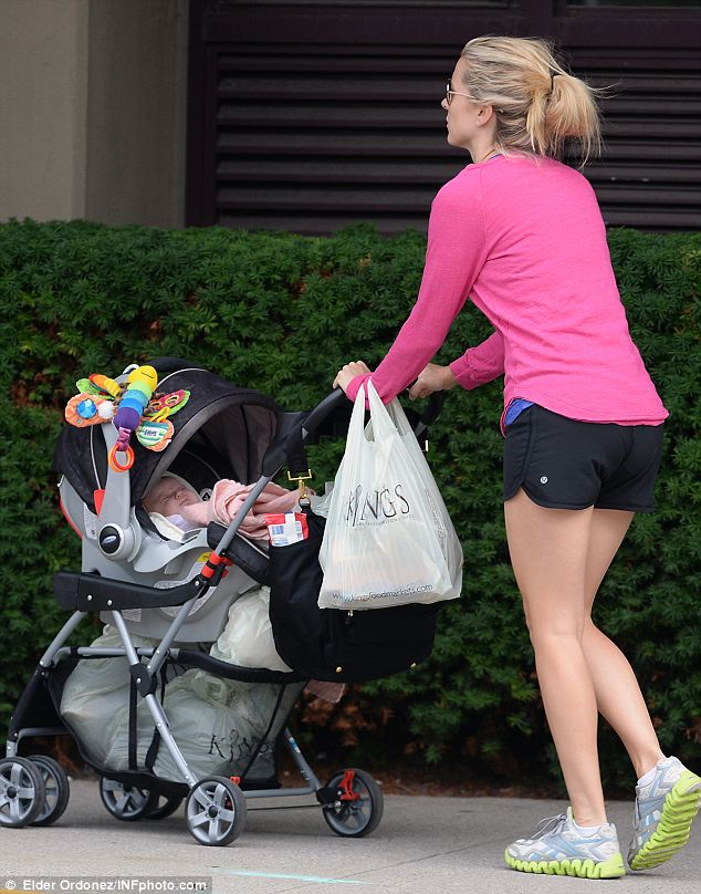 Out and about: Eli Manning's wife Abby is seen on a stroll in Hoboken with their newborn daughter Lucy