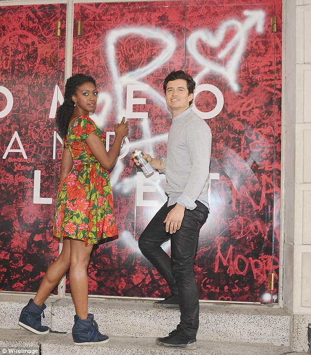 Rebels: The pair showed their rebellious streak by doing graffiti on a wall, including a scribbling of their initials and a cute love heart