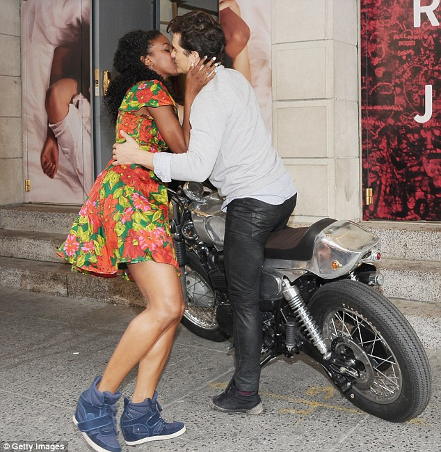 What would Miranda think? Orlando Bloom kissed his co-star Condola Rashad on the lips at a photo call for their new play Romeo And Juliet in New York on Wednesday