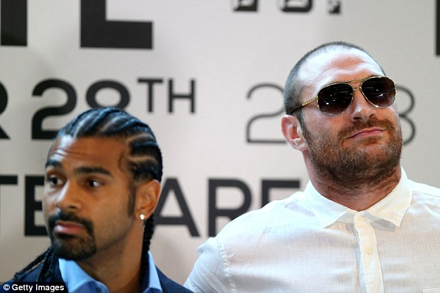 Battle: Fury (right) takes on Haye in Manchester on September 28