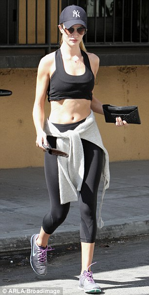 The model and actress strolls back to her car after a morning of grueling exercise at the Studio City gym