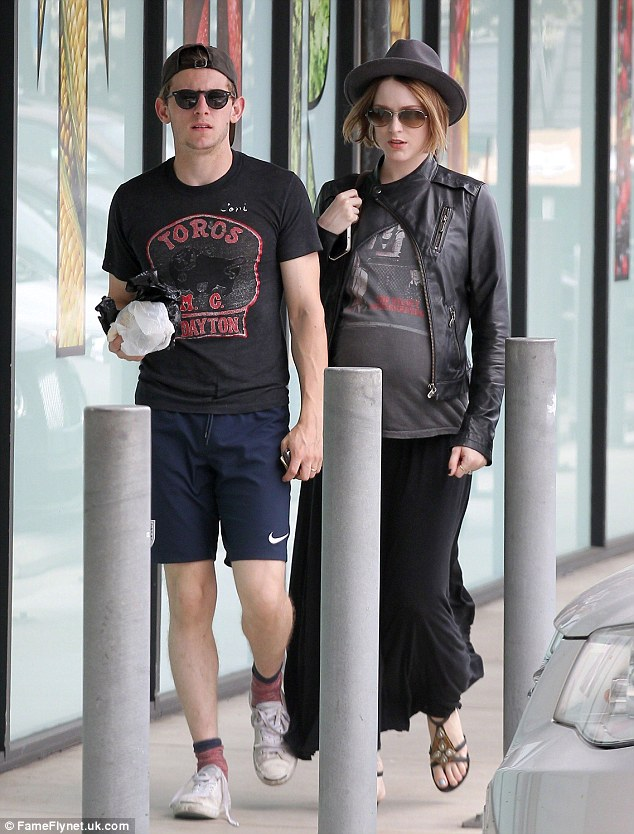 Any day now: A very pregnant Evan and Jamie visit a grocery store in Malibu last month just before she gave birth to their son