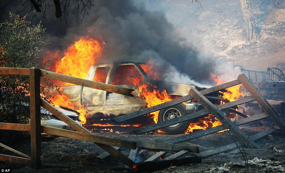 Anything in the path of the wildfire was destroyed by the blaze as it roared through a residential area near Hwy 243 and Twin Pines Road, including this pickup truck