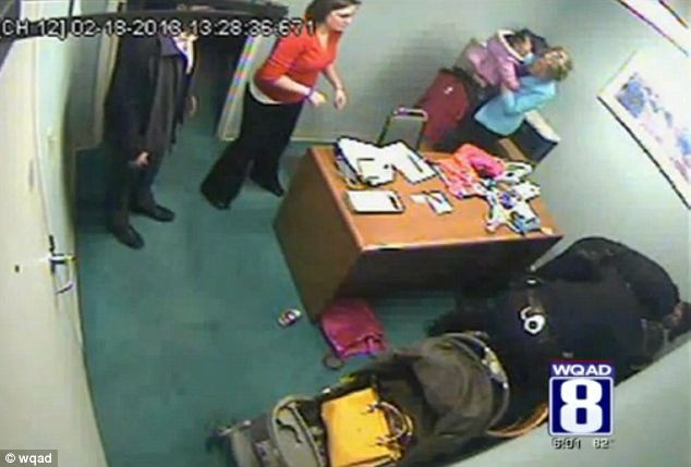 Departure: During the attack a store worker leaves with Redell's one-year-old child (top of picture)