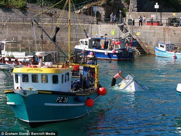 Rescue: The fishing vessel towed Mr Hill and his trailer in to the harbour in Newquay