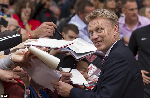 Welcome: Manchester United's manager David Moyes signs autographs at Old Trafford