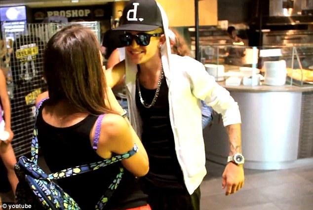 Prank: Jeremy Frost greets a Justin Bieber fan who believes he is the 19-year-old pop-star