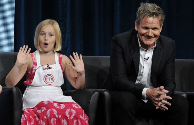 Celebrity chef  Gordon Ramsay with a contestant on  Junior Masterchef