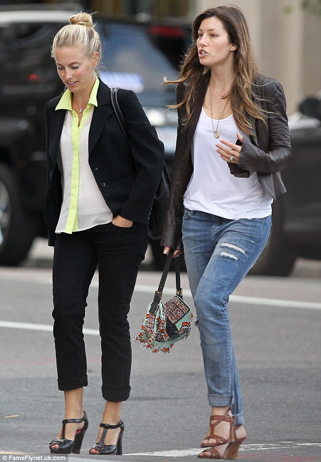 Girl time: Jessica was joined by a female friend as they walked around Beantown before catching the two-night performances at Fenway Park