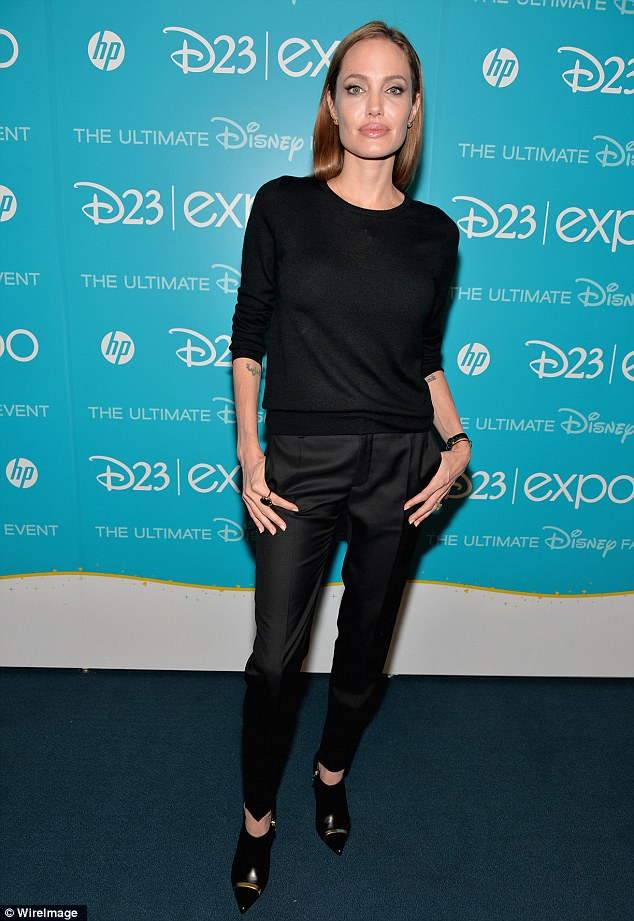 Wicked witch: Angelina Jolie did her best menacing scowl as she promoted live-action Disney flick Maleficent Saturday in Anaheim, California