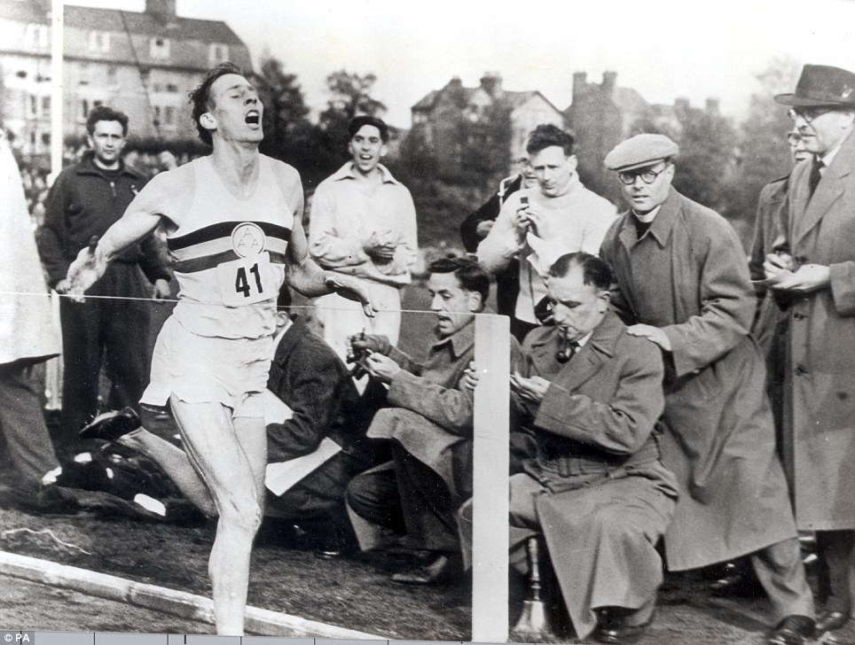 Roger Bannister crosses the finish line to run the first sub-four minute mile on May 6 1954