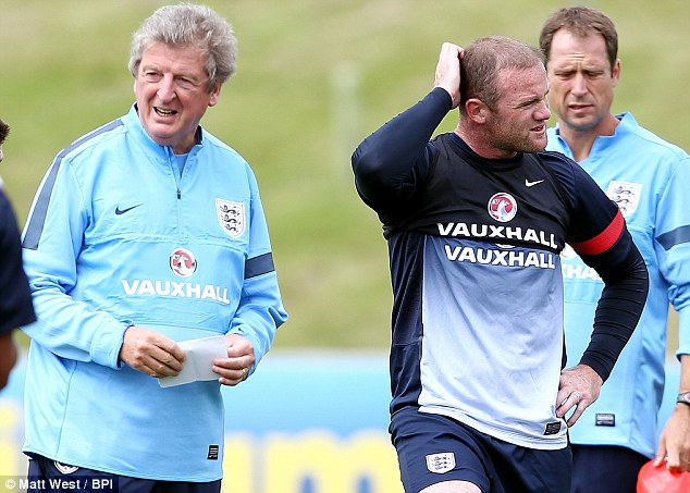 Fit and firing? Wayne Rooney took to England training half an hour early on Monday at St George's Park