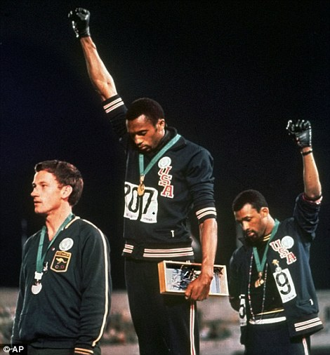 American athletes Tommie Smith (left) and John Carlos (right) give the Black Power salute at the 1968 Olympics in Mexico City after taking gold and bronze respectively in the 200m