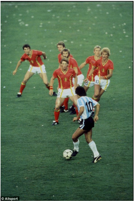 Argentina's Diego Maradona takes on the Belgium defence during the 1982 World Cup in Spain
