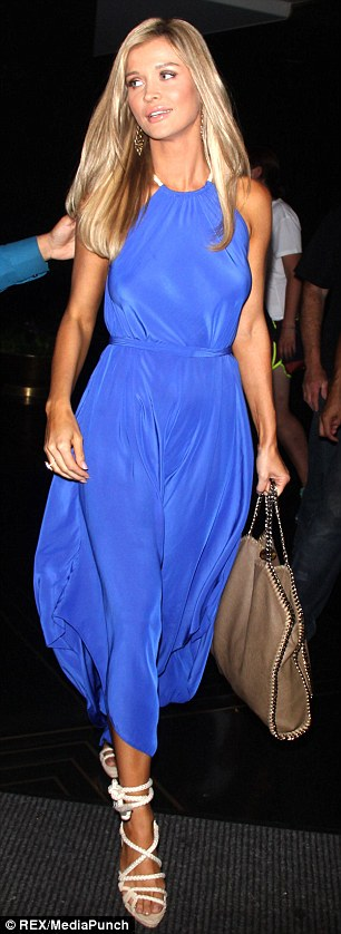 Ethereal beauty: The 34-year-old looked elegant in the asymmetrical frock, which she paired with strappy white heels and a beige handbag