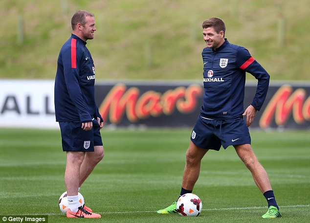 Powers of persuasion: Steven Gerrard (right), training with England, says he will try to make Suarez stay at the club