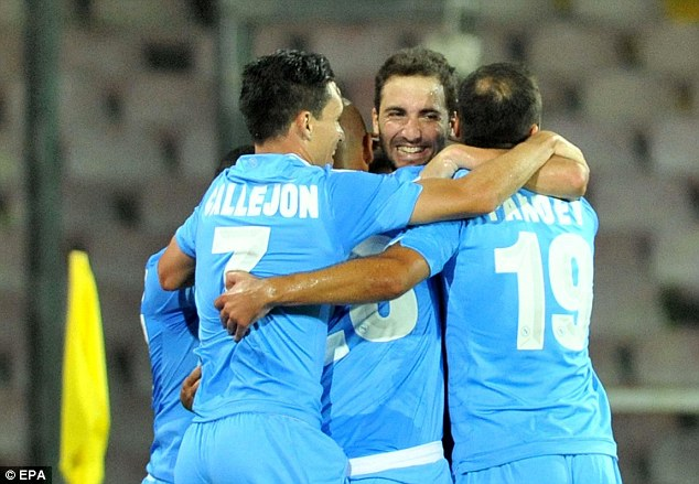 One that got away: Gonzalo Higuain (centre) left for Napoli. Here, he celebrates scoring against Benfica