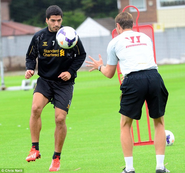 Lean on me: Luis Suarez claims he wants to stay at Liverpool, according to Uruguayan media