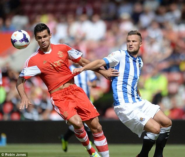 New face: Dejan Lovren (left) signed from Lyon for £8.5m