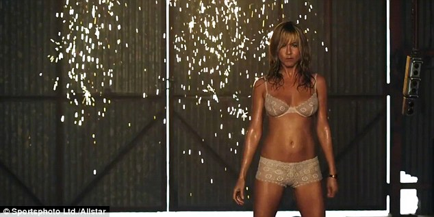 Racy! Jennifer strips down to her underwear as she performs a sexy striptease in We're The Millers