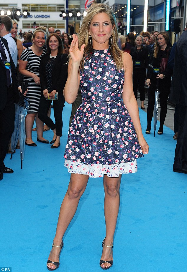 Style departure: Jennifer Aniston enjoyed a complete departure from her usual style as she attended the UK premiere of her new movie, We're The Millers, at London's Odeon Leicester Square on Wednesday night