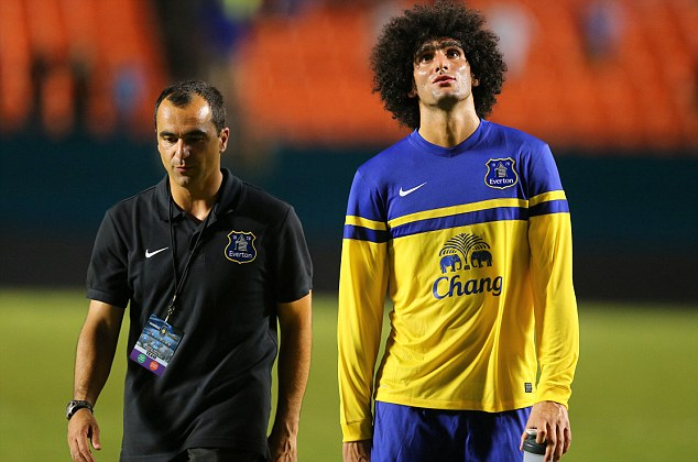 Set to stay? Roberto Martinez (left) insists that Maroaune Fellaini's (right) departure will not be 'straightforward'