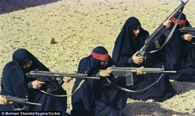 Arms for hostages: Iranian women trained near Tehran with weapons likely provided by the U.S. via middle-man countries in the 1980s. Klein and Elliott claim a similar U.S. scheme was arming Syrians