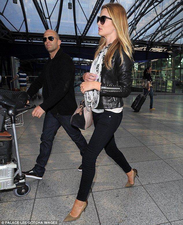 She just loves it! Rosie was previously seen wearing the leather jacket as she arrived back in London earlier this week