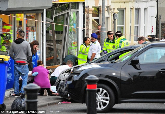 Carnage: A woman accused of mowing down a pedestrian and then reversing back over him and into a kebab shop has blamed the crash on her flips flops.