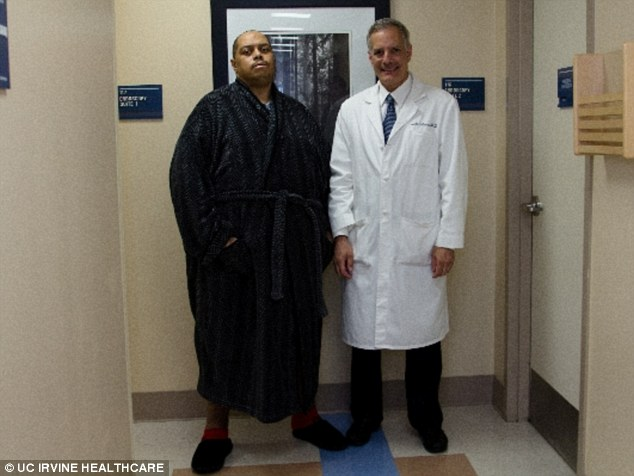 After: Wesley Warren Jr, left, is shown with Dr Joel Gelman, who led a team of surgeons and nurses in correcting the abnormality that Warren endured for five years
