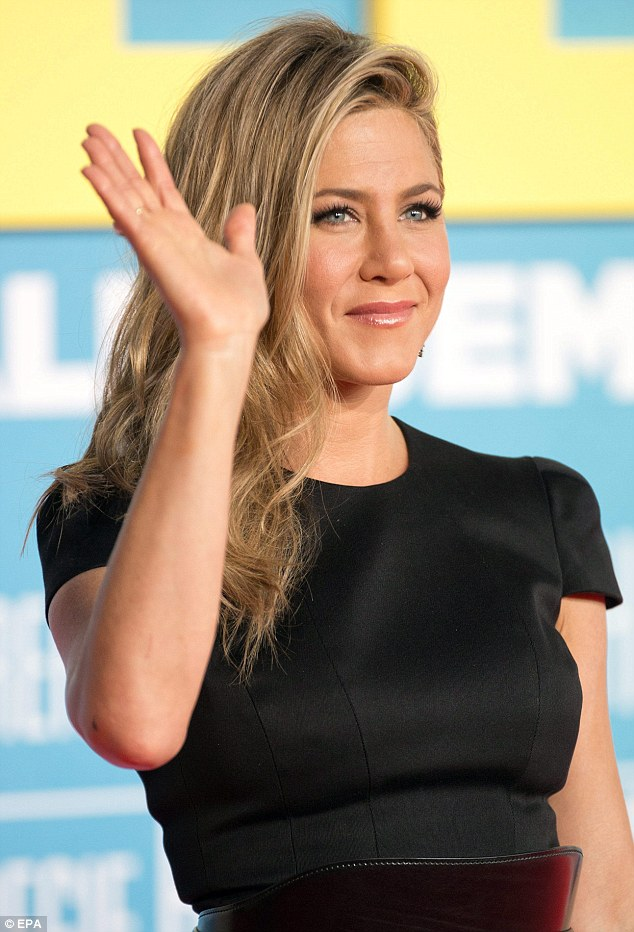 Movie star glam: Jennifer wore her honey blonde locks swept to one side and tumbling across her shoulder in a cascade of waves as she waved to the crowd