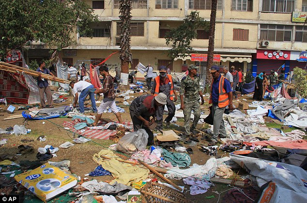 Aftermath: Egyptian soldiers and people sift through debris spread out by the Rabaah al-Adawiya mosque in Cairo's Nasr City, Egypt