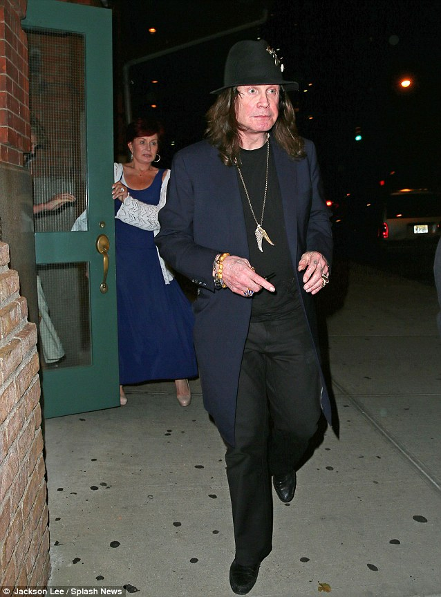 He's off! Ozzy leads the way as Sharon follows her husband of 30 years out of the restaurant