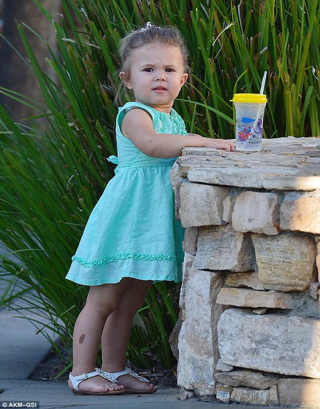 Birthday girl: The two-year-old, who looked sweet in a pretty green dress and white sandals on her big day, has had an eventful week, taking on flower girl duties at her parents' Las Vegas wedding last weekend