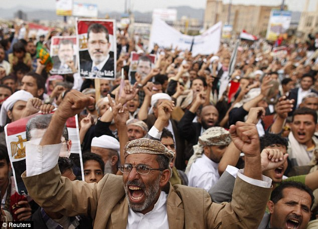 Fury: Muslim Brotherhood supporters in Sanaa shout slogans during the rally in protest at the recent violence in Egypt