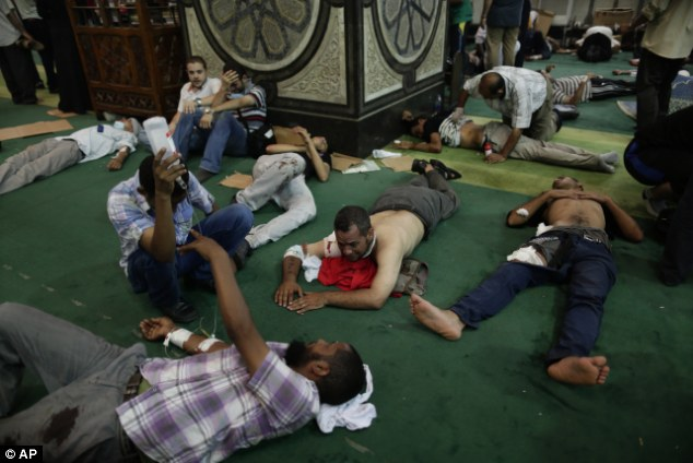 Temporary care: The Al-Fath mosque was turned into a field hospital after armed police opened fire outside Azbakeya Police Station