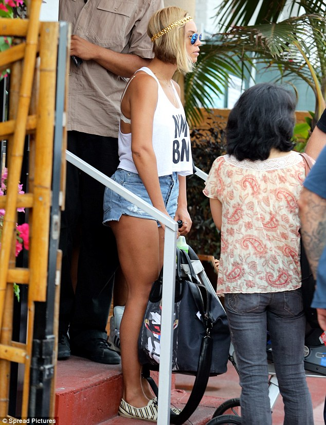 Pram pusher: Beyoncé showed off her thick, strong legs as she wheeled Blue Ivy down the steps